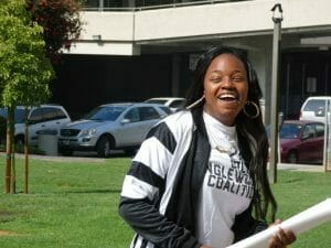 Dominique Brown of Uplift Inglewood celebrates outside Inglewood City Hall after the organization turned in over 2000 petitions to put a rent control ballot initiative to a citywide vote