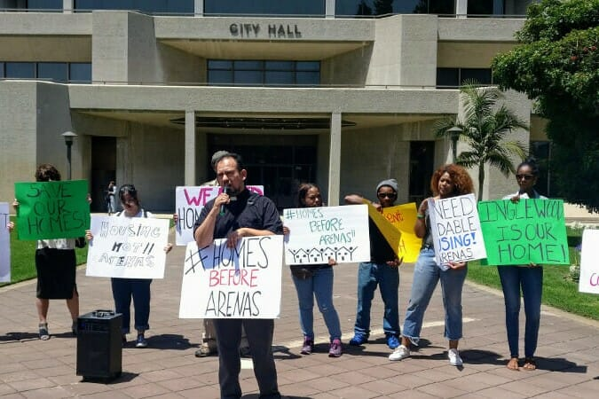 Reverend Francisco Garcia of the Uplift Inglewood Coalition speaks to protesters outside City Hall